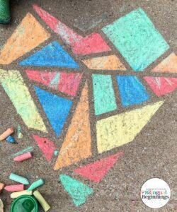 Mosaic Heart Chalk Activity for Preschoolers #chalkactivities #chalkart #outdoorchalkactivities #grossmotoractivities #finemotoractivities #preschoolactivities #funpreschoolactivities #preschoolartprojects #colorlearningactivities