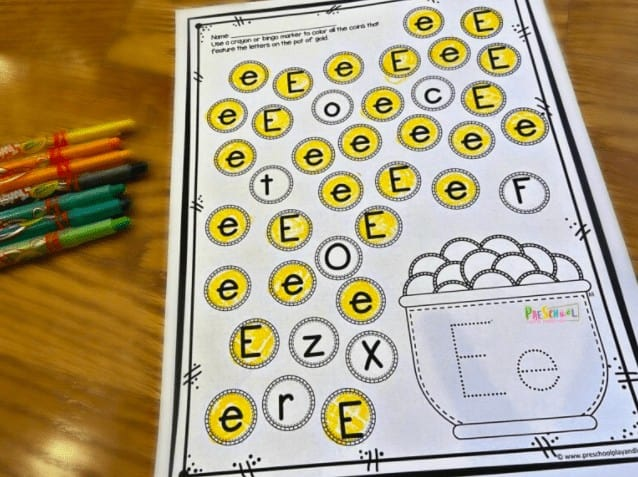"""8. Pot of Gold Letter Find St Patricks Day Printable Worksheets - with Preschool Play & Learn""""Make working on letter discrimination FUN with these super cute, Pot of Gold St. Patrick's day worksheets."""""""