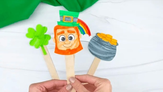 """22. Popsicle Stick St. Patrick's Day Puppets - With Simple Everyday Mom""""If you have kids at home who love to play pretend, these popsicle stick St. Patrick's day puppets are the perfect activity for them to do!"""""""
