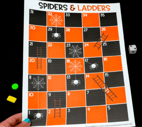 """20. Spiders and Ladders - with Rock Your Homeschool""""Play a simple yet super fun Halloween game with your kids featuring cute spiders & ladders."""""""
