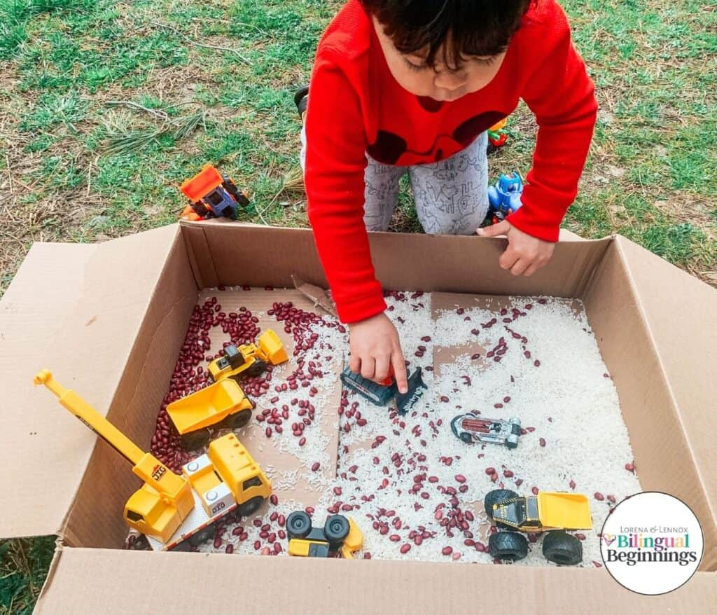 """1.Construction Zone Sensory Bean Box - With Bilingual Beginnings""""Your toddler will be intrigued for hours with this activity, all while getting some great sensory and fine motor play."""""""